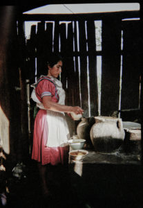 """Cocina"" — Doña Soyla is serving out the food. Armando Vásquez Morales, 1997. Tojolabal ethnic group."